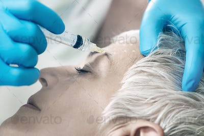 Botulinum Toxin Injections. Senior Woman Receiving Botulinum Tox