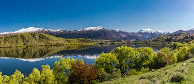 Lake Hayes reflecting Coronet  mountains, near Queenstown, New Z