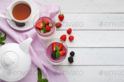 Sweet summer layered dessert with fresh berries