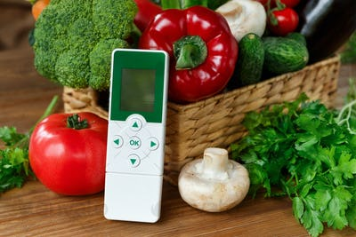Nitrate tester and various vegetables on wooden background