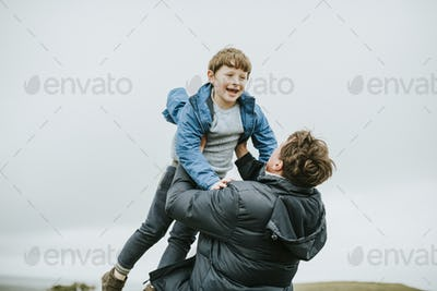 Happy father and son enjoying together