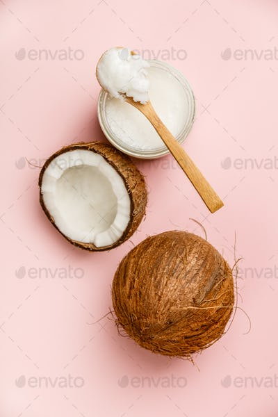 Coconut oil and fresh coconuts, flat lay