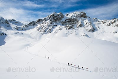 Group of climbers roped to the summit