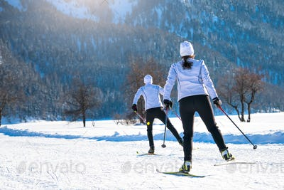 Couple man and woman cross-country skiers
