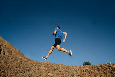 athlete runner running uphill