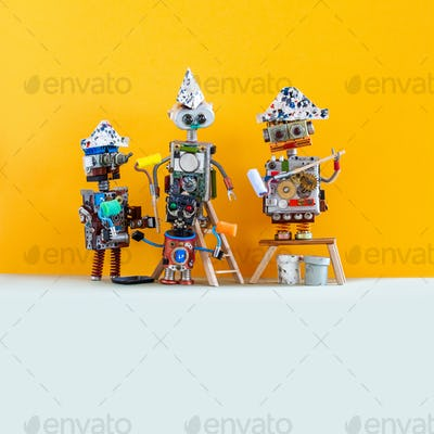 A team of robot decorators painters against a yellow wall. Funny toy robots are ready to redesign