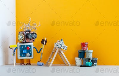 Painter decorator robot ready for interior maintenance. Room redecorating concept. Funny robot toy