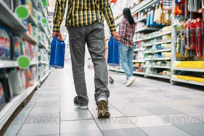 Man with engine oil, couple in supermarket