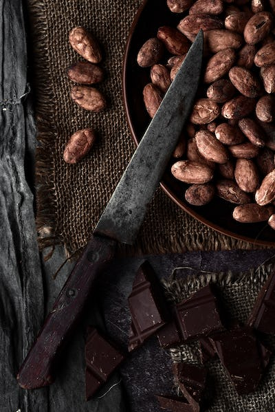 chocolate and cocoa beans and old knife