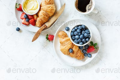 Breakfast with coffee, berries and croissant