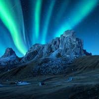 Northern lights above mountains at night. Aurora borealis