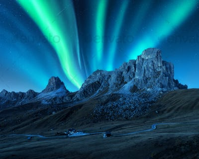 Northern lights above mountains at night. Aurora borealis