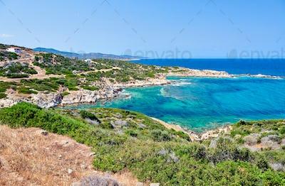 Beautiful beach and rocky coastline landscape in Greece
