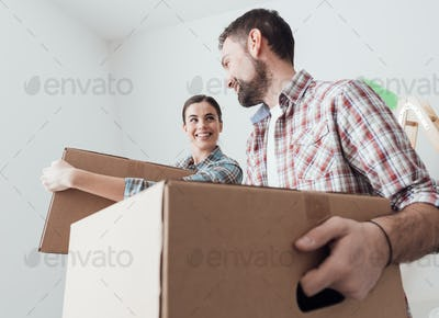 Young couple moving into a new house