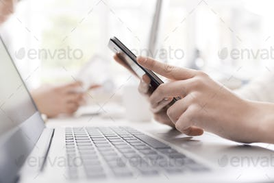 Woman using her smartphone and connecting
