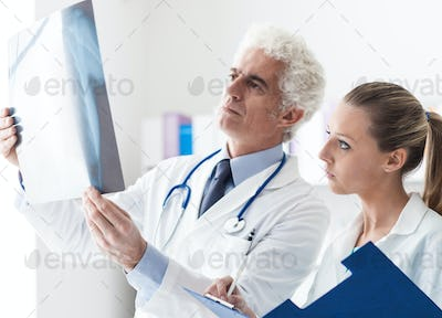 Medical team examining a patient's x-ray