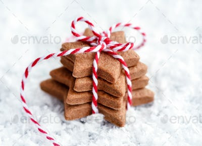 Christmas cookies - fresh baked star shaped biscuits on the snow