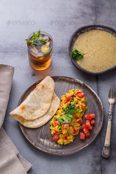 Scrambled eggs with onion and indian spices, indian cuisine
