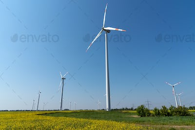 Wind energy plants in front of a clear blue sky