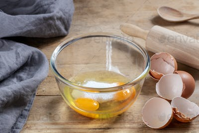 bowl of eggs and sugar