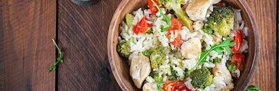 Delicious chicken, broccoli, green peas, tomato stir fry with ri