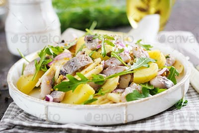 Traditional  salad of salted herring fillet, fresh apples,  red onion  and potatoes.