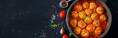 Chicken meatballs with tomato sauce in a pan. Dinner. Top view.