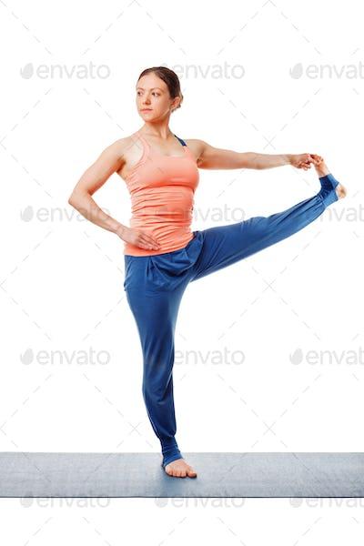Woman doing Ashtanga Vinyasa yoga asana Utthita hasta padangustasana