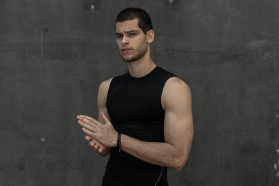 Attractive strong fashionable sporty sportive muscular man