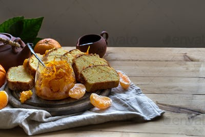 Tangerine cake with tea background