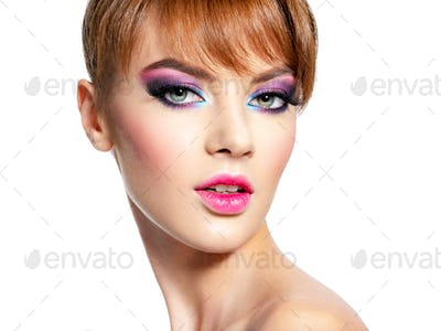 Beautiful woman with bright professional make-up.