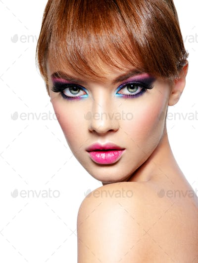 Beautiful woman with bright vivid purple make-up.