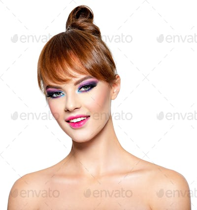 Beautiful woman with fashion make-up and hairstyle