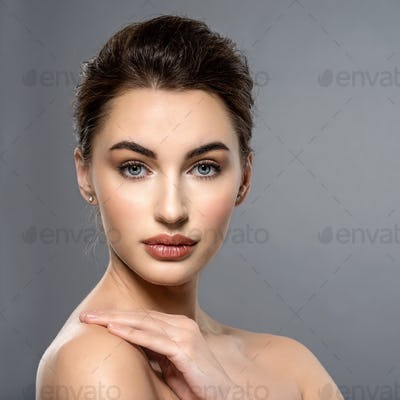 Beautiful face of  a caucasian woman with clean fresh skin.