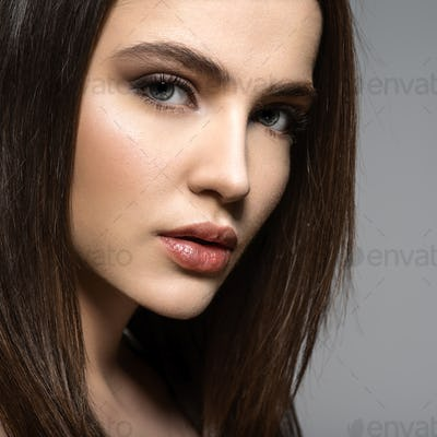 Closeup face of a Fashion model with straight   hair.