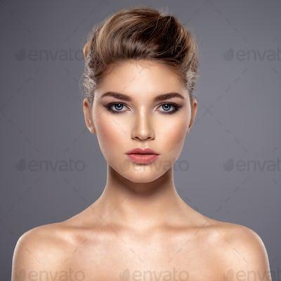 Beautiful face of young caucasian woman