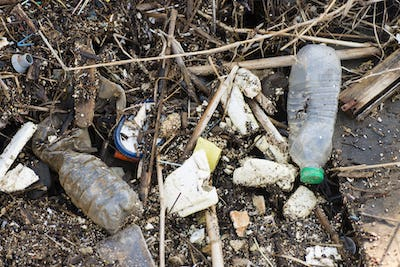 Plastic and litter material on sand beach