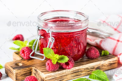 Strawberry jam in glass jar.