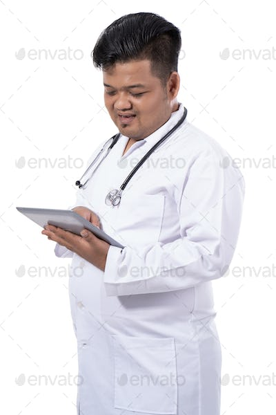 images of a serious doctor holding tablet digital