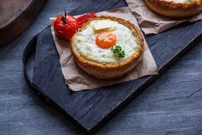 Breakfast with baked cheese and egg yolk filled buns