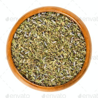 Herbes de Provence in wooden bowl over white