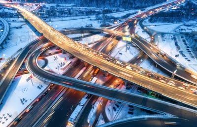 Aerial view of road in the modern city at night in winter