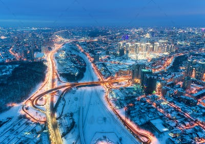Aerial view of beautiful modern city at cold night in winter