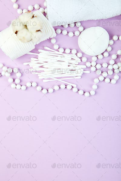 Branch of cotton plant, eared sticks, cotton pads,