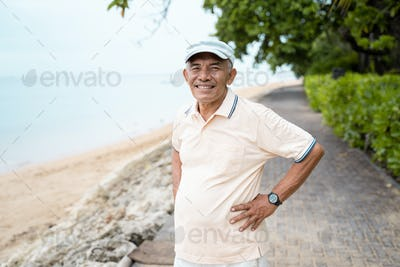 asian mature man smiling to camera