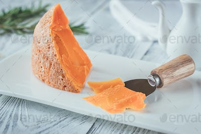 Mimolette cheese on white plate