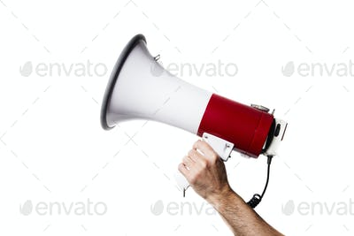isolated portrait of a hand holding a megaphone