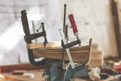 handcrafted craftwork of a wooden boat model