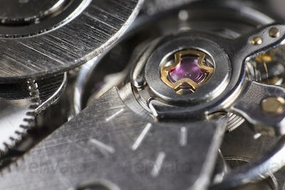 Macro detail of the ruby in the mechanism of a wristwatch