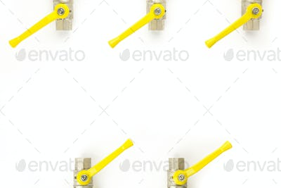 Aerial view of a set of faucets with yellow lever isolated on w